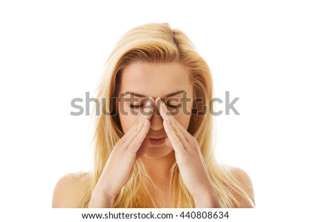 Woman with sinus pressure pain. - stock photo