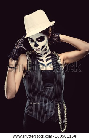Woman with skeleton face art over black background  - stock photo