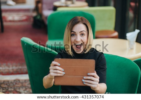woman with smart tablet in coffee shop
