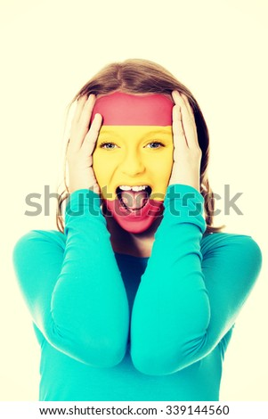 Woman with Spain flag painted on face. - stock photo