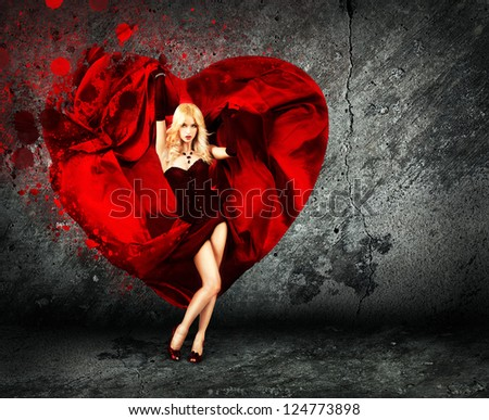 Woman with Splashing Heart on Dark Background - stock photo