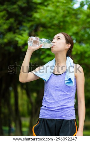Woman with sport wear and drink with water