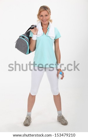 Woman with sports bag - stock photo