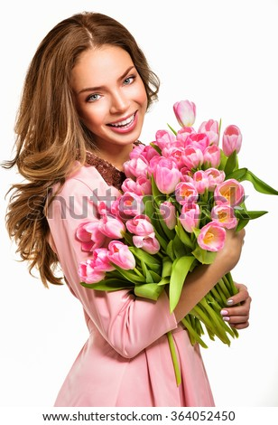 Woman with Spring Flower bouquet. Happy surprised model woman smelling flowers. Mother's Day. Springtime - stock photo