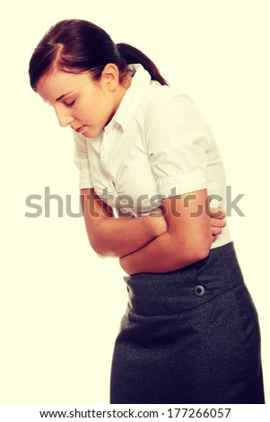 Woman with stomach issues isolated on white background