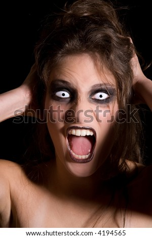 Woman with strange white eyes screaming her lungs out