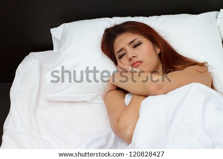 woman with stress or insomnia in bedroom