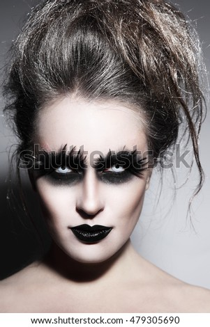 Woman with stylish fancy gothic Halloween make-up and hairdo