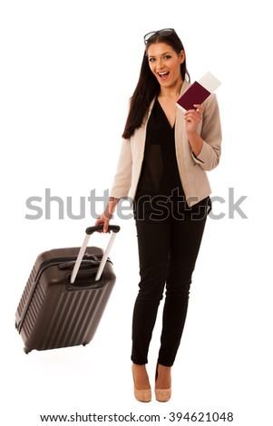Woman with suitcase and travel documents going on a business trip. - stock photo