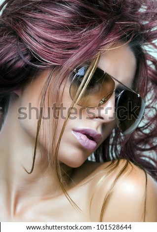 Woman with sunglasses and beautiful purple hair - stock photo
