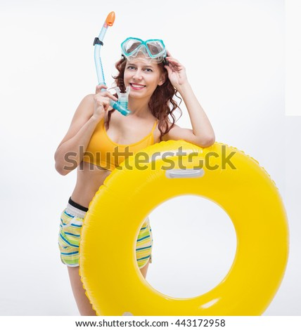 woman with swimming accessories on white background - stock photo