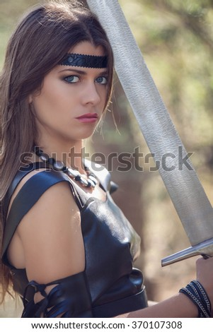 woman with sword, cosplay fantasy fiction - stock photo