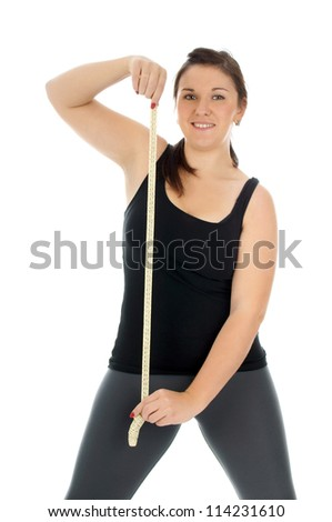 Woman with tape measure / sporty woman - stock photo