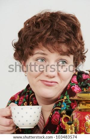 Woman with tea - stock photo