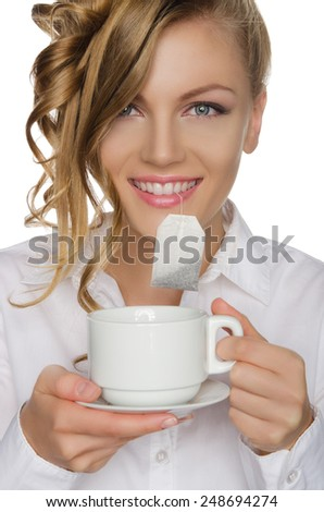 woman with tea bag in your mouth and cup isolated on white