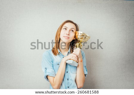 woman with the cup winner. isolated on gray background
