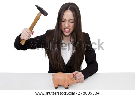 woman with the hammer breaking piggy bank - stock photo
