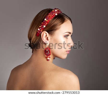 Woman  With The Hoop And Stylish Earrings