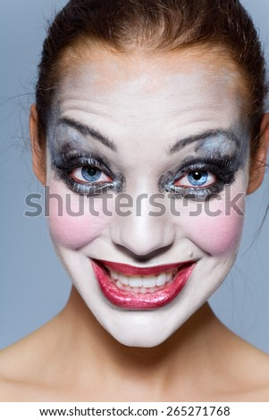 Woman with thick makeup making faces. - stock photo