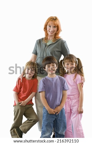 Woman with three children, smiling, portrait, cut out - stock photo