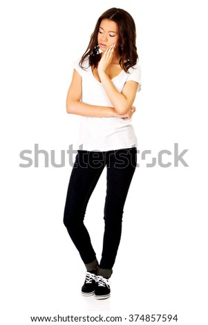 Woman with toothache touching face. - stock photo