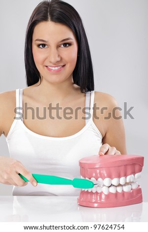 Woman with toothbrush and jaws , brushing teeth the right way