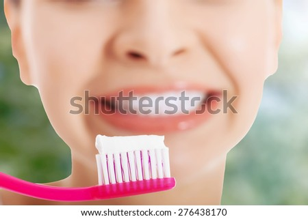 Woman with toothbrush and paste. - stock photo