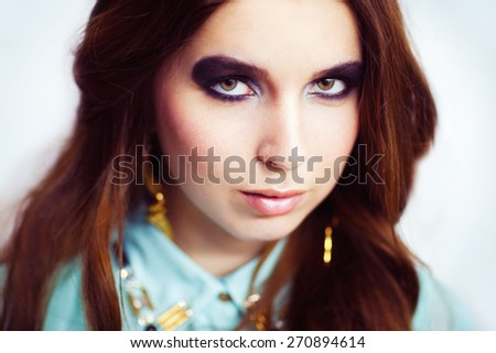 Woman with trendy smokey eyes makeup and beautiful long hair - stock photo