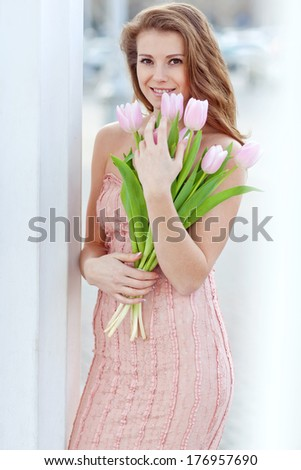 Woman with tulips - stock photo