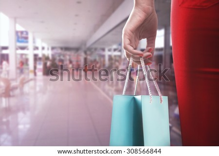 Woman with two shooping bags - stock photo