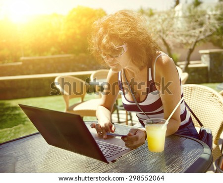 Woman with ultrabook