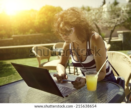 Woman with ultrabook . applied tinting