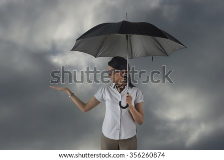 Woman with umbrella feeling for rain