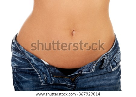 Woman with unbuttoned jeans.