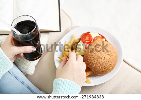 Woman with unhealthy fast food, close-up  - stock photo