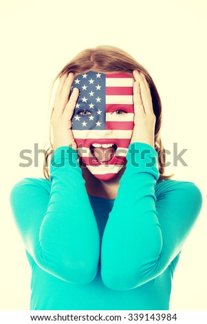 Woman with usa flag painted on face. - stock photo