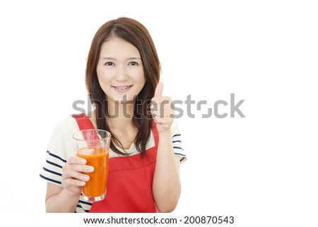 Woman with vegetable juice