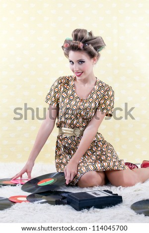 Woman with vinyl record on white carpet. - stock photo