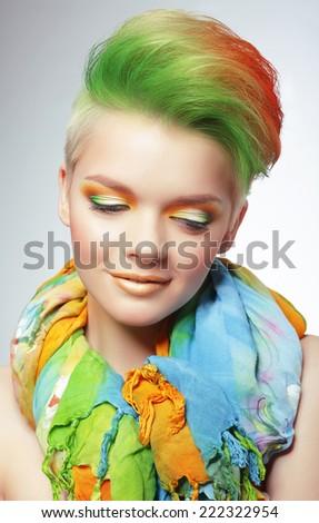 Woman with Vivid Multicolored Bob Haircut and Bright Makeup - stock photo