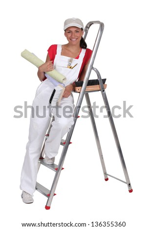 Woman with wallpaper - stock photo