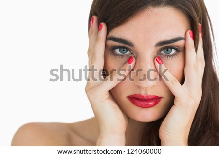 Woman with wavy brown hair wearing the colour red on lips and nails - stock photo