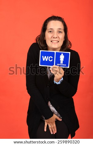 Woman with WC sign - stock photo