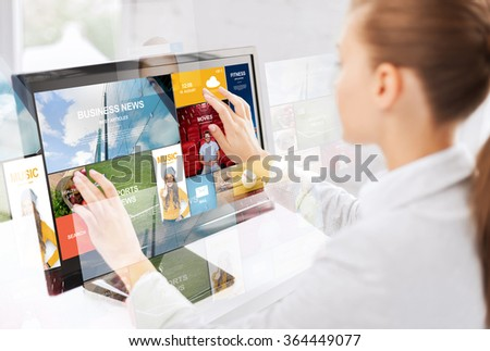 woman with web pages on touchscreen in office