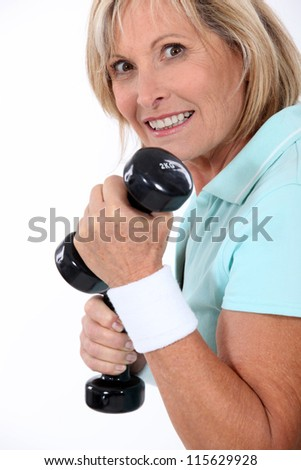 Woman with weights - stock photo