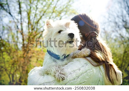 woman with west highland terrier - stock photo