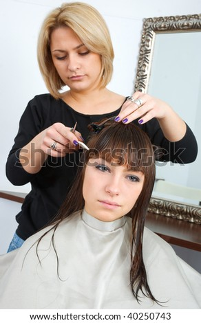 woman with wet hair in hair salon having treatment - stock photo