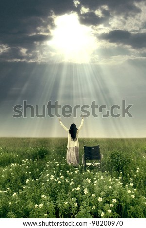 Woman with wheelchair is being healed by God. Shot outdoor - stock photo