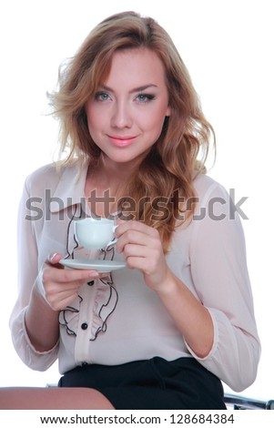 Woman with white coffee cup/Smiley girl is holding coffee cup and sitting on a stool - stock photo