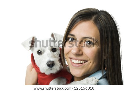 Woman with white dog in hooded sweatshirt