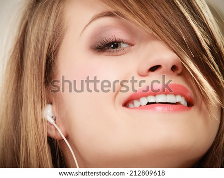 Woman with white headphones listening to music. Student girl learning language with new technology. - stock photo